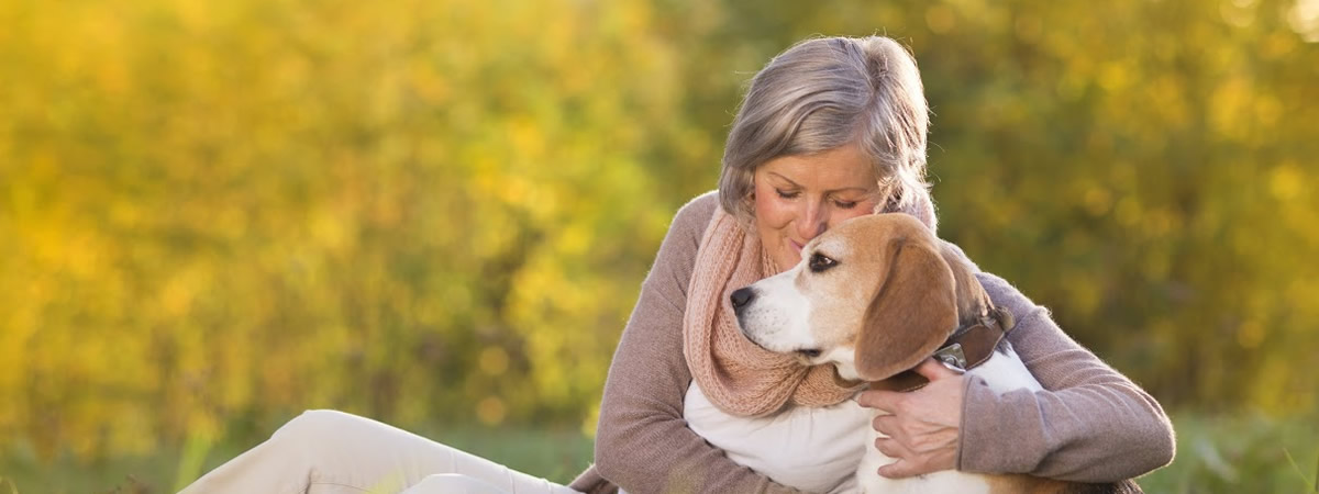 bigstock-Active-senior-woman-hugs-dog-56728436