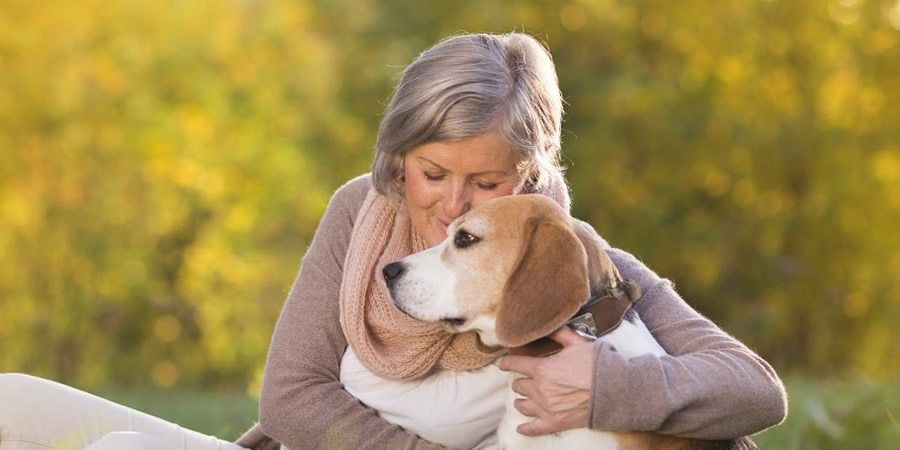 bigstock-Active-senior-woman-hugs-dog-56728436small